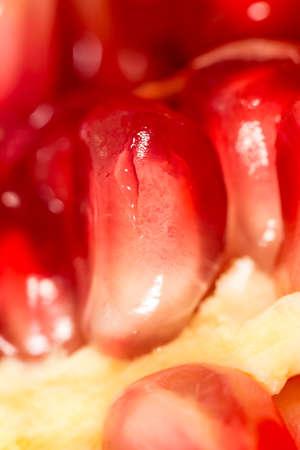 pomegranat: ripe pomegranate. Super Macro Stock Photo