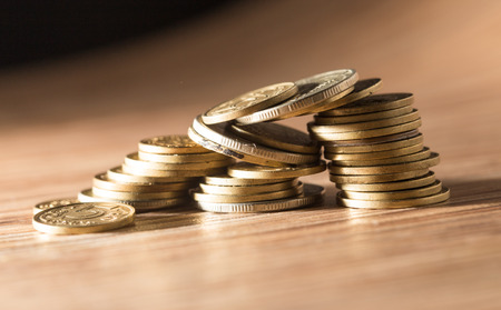 gold coins: coins on the table. close-up