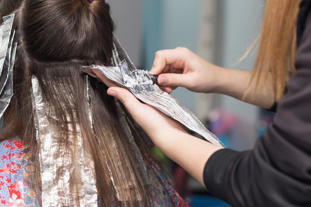 hair coloring in a beauty salon photo