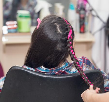 weave braids in a beauty salon Stock Photo