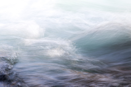 background of turbulent water in the mountain river Banco de Imagens