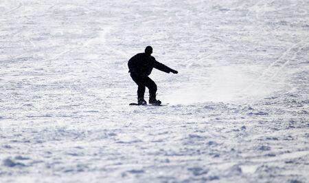 flattened: Snowboarding man at flattened piste - slope
