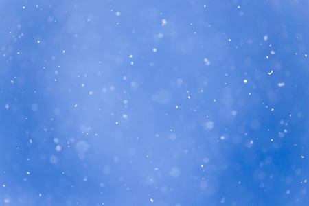 snowing: snowing on a blue sky