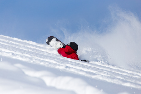 ski traces: snowboarder falls to rate Stock Photo