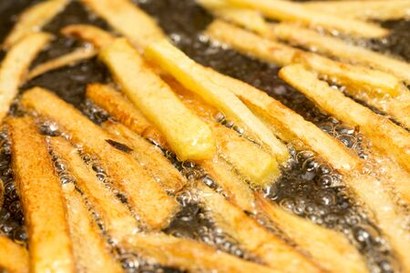 French fries fried in a pan photo