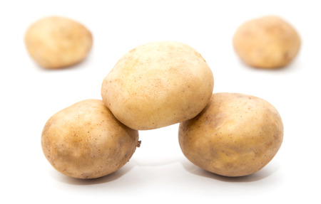 spud: potatoes on a white background Stock Photo