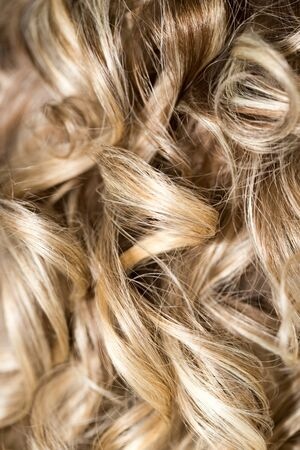 perming: Curly Hair. Hairdressing. Wave .Natural Hair Stock Photo