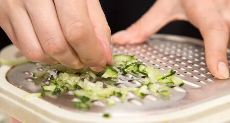 metal grater: sliced cucumber on a grater Stock Photo