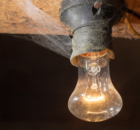 wooden  ceiling: old lamp burning on a wooden ceiling