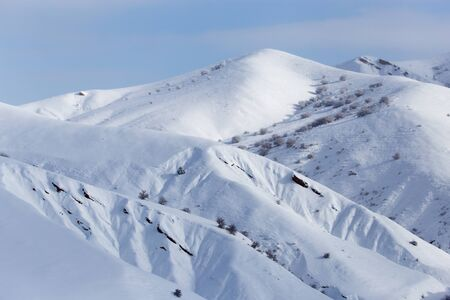 tien shan: snowy slopes of the Tien Shan Mountains Stock Photo