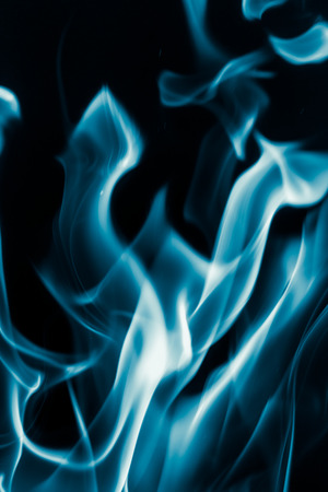 blue flame fire on a black background Stock Photo
