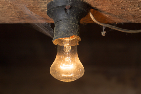 sight seeing: old lamp burning on a wooden ceiling