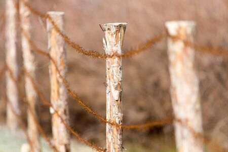 trespass: Barbed wire on nature Stock Photo