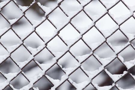 barbwire: Close-up of barbwire covered by snow Stock Photo