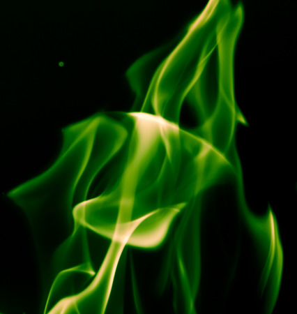 flame background: green flame fire on a black background Stock Photo