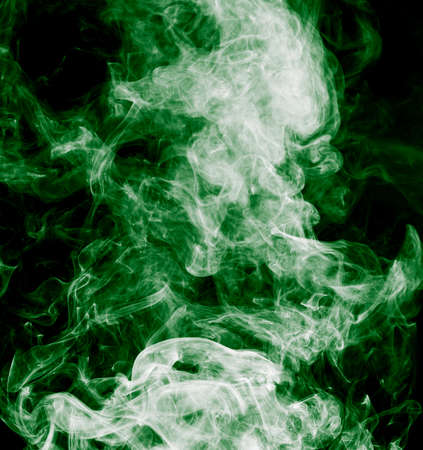 noxious: green smoke on a black background Stock Photo
