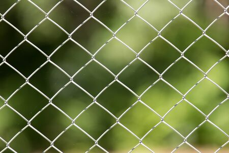 security gap: Metal fence in nature  Stock Photo