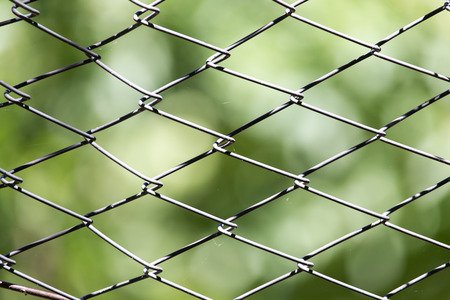 grille: Rusty metal grille fence macro and nature background