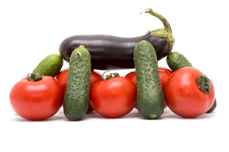 volatility: cucumbers, tomatoes and eggplant on a white background Stock Photo