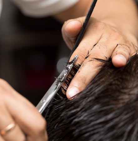 hairdresser's parlor: mens hair cutting scissors in a beauty salon