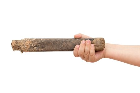 a cudgel: stick in childrens hand on white Stock Photo