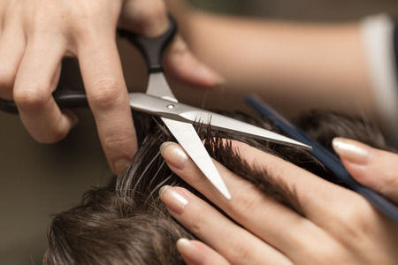 cut: mens hair cutting scissors in a beauty salon