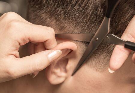 hairdresser's parlor: Haircut ear in a beauty salon