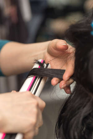 permanent wave: Permanent hair in a beauty salon Stock Photo