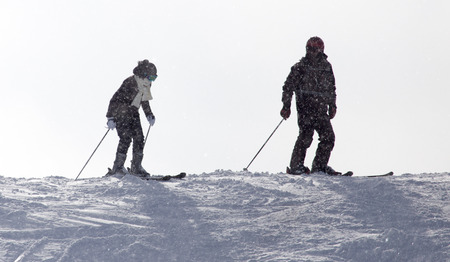 SKI: People skiing in the snow Stock Photo
