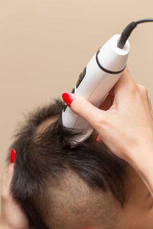 haircut: Man having a haircut with a hair clippers Stock Photo