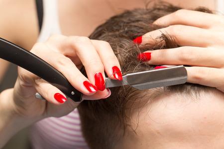 haircut: razor haircut at the beauty salon