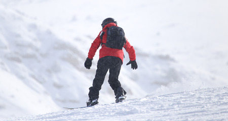 piste: Snowboarding man at flattened piste - slope