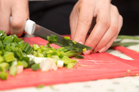 potherbs: sliced green onions with a knife