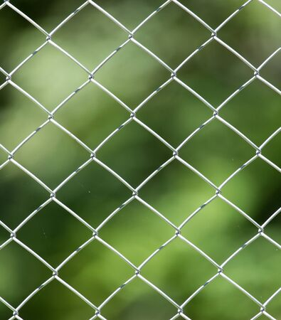 security gap: metal fence in nature as a background