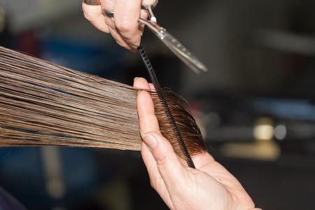 scissor cut: cutting hair in a beauty salon
