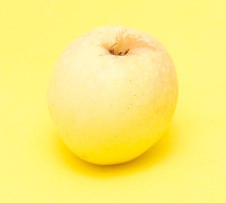 yellow: ripe apple on a yellow background