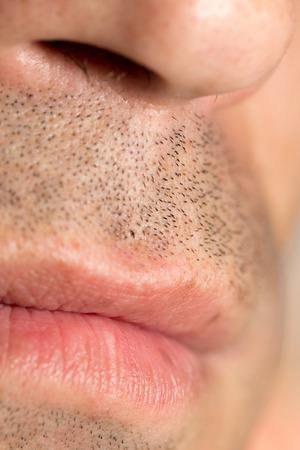 smoothfaced: Mens lips. close Stock Photo