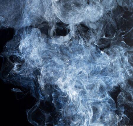 black swirls: Smoke fragments on a black background