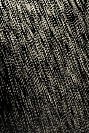 high end: yellow rain on a black background Stock Photo