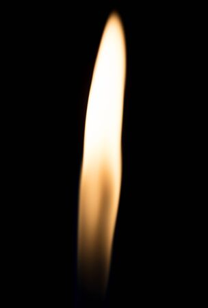 cigarette lighter: a flame of fire from the cigarette lighter on a black background Stock Photo