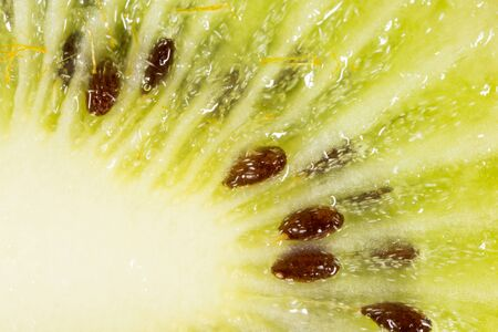 juicy: juicy kiwi as background. macro Stock Photo