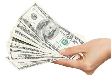 efectivo: Dólares en la mano sobre un fondo blanco
