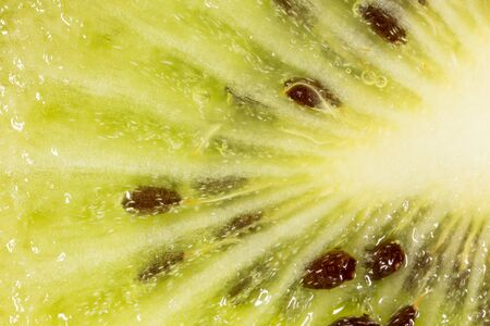 juicy: juicy kiwi as background. macro Stock Photo