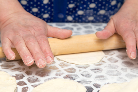 sheeting: sheeting the dough with a rolling pin in the kitchen Stock Photo