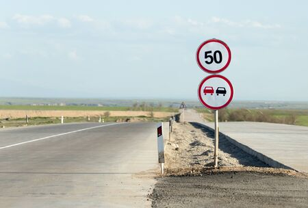 overtaking: mark overtaking is forbidden on the road Stock Photo