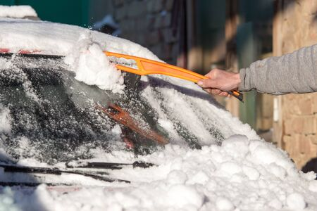 scraping: scraping snow from car winter Stock Photo