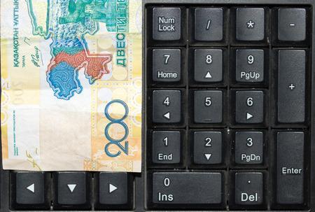 kazakh: Kazakh tenge on the laptop keyboard Stock Photo