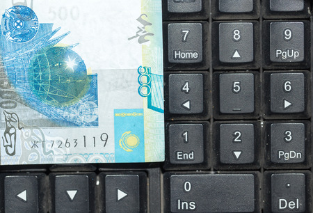 kazakh: Kazakh tenge on the laptop keyboard Stock Photo