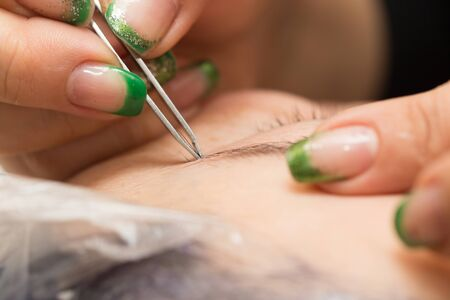 correction: correction of eyebrows in a beauty salon