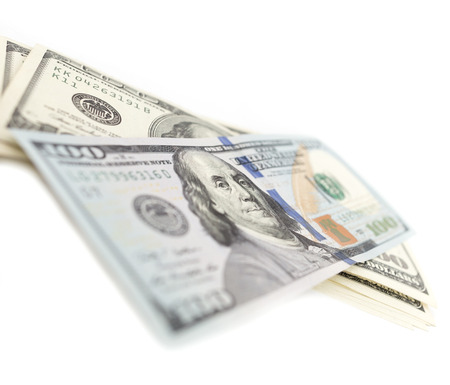 large group of items: dollars on white background Stock Photo